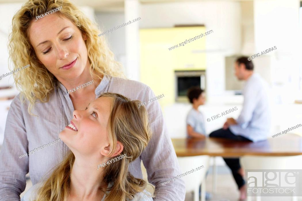 Stock Photo: Girl looking at her mother and smiling.