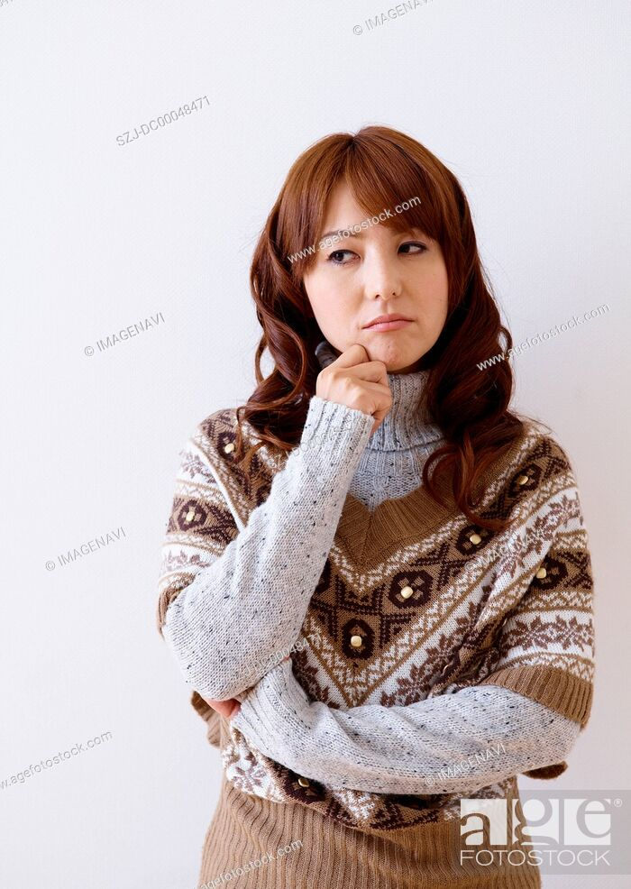 Stock Photo: Middle-aged woman thinking.