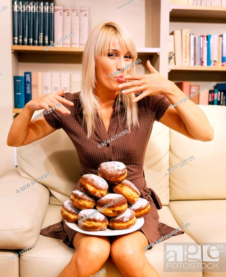 Stock Photo: Woman with donuts.