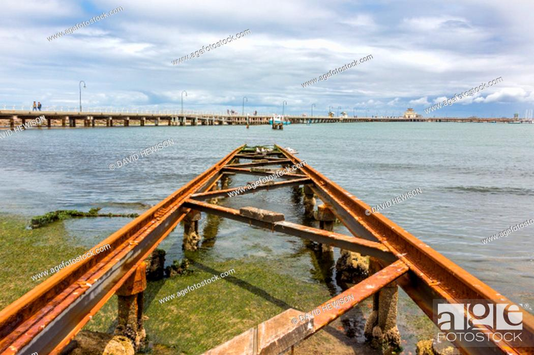 Stock Photo: St Kilda Pier with an old boat slipway in the foreground. St Kilda, Australia.