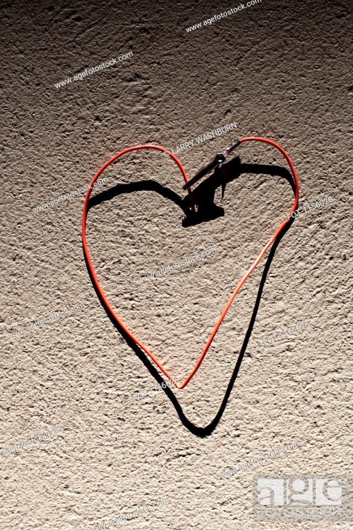 Stock Photo: A red wire bent into the shape of heart.
