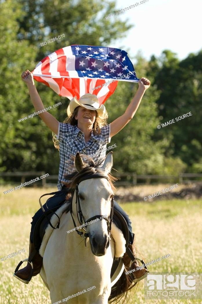 Stock Photo: A girl holding the american flag.