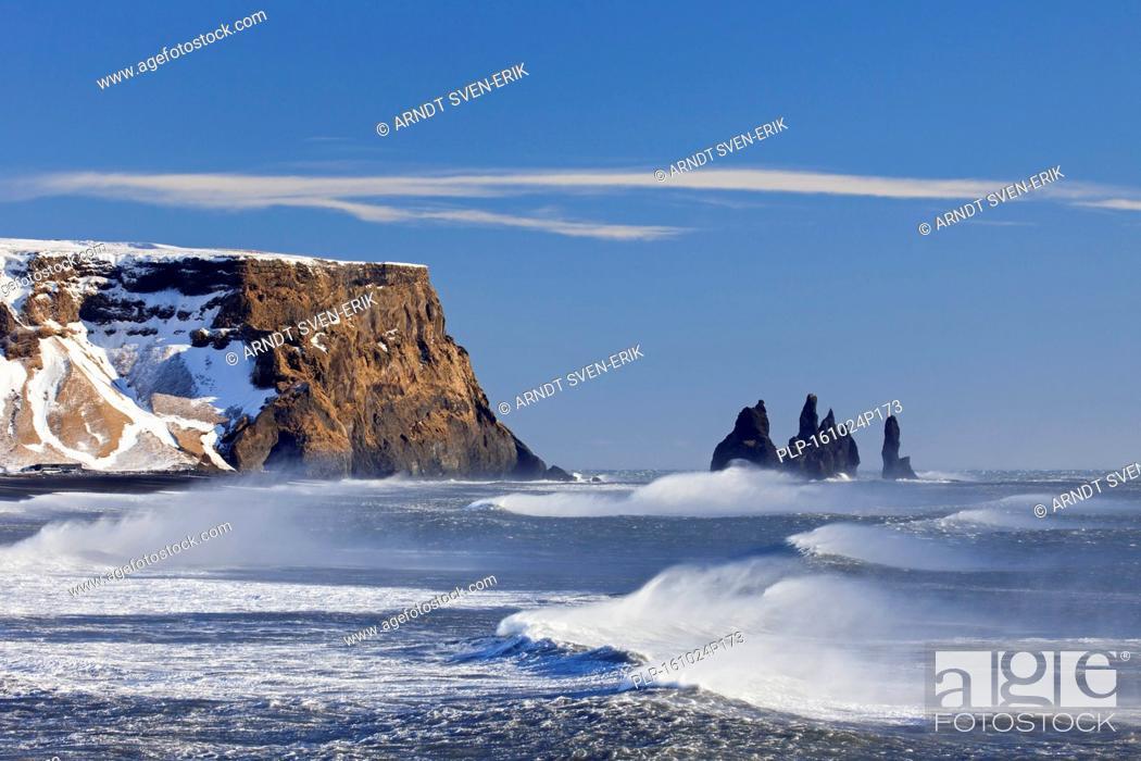 Stock Photo: Reynisdrangar, basalt sea stacks in the snow in winter near the village Vík í Mýrdal, southern Iceland.