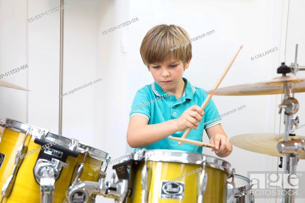 Stock Photo: A child playing the drums.
