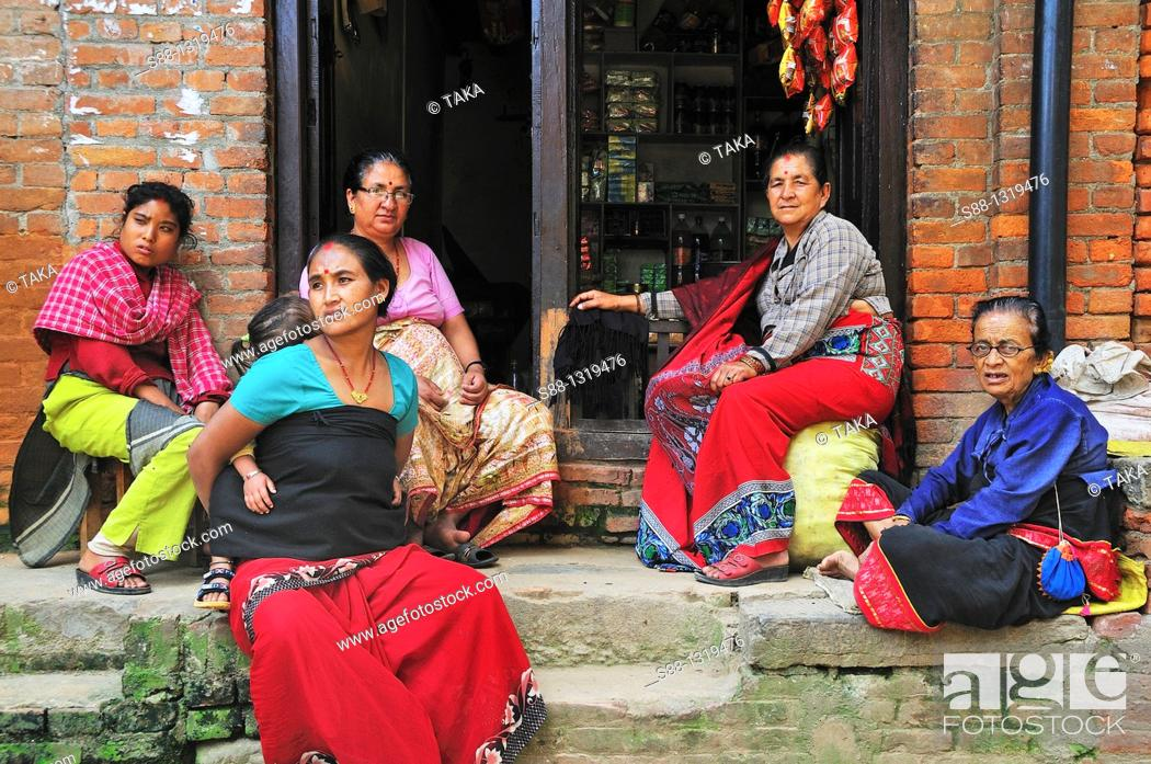 Stock Photo: Women sitting together in front of the shop, Bhaktapur Bhadgaon Kathmandu valley Nepali.