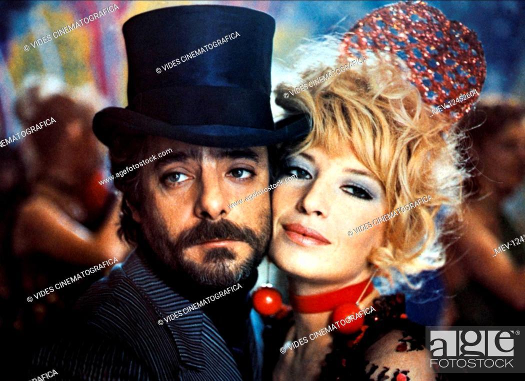 Stock Photo: Giancarlo Giannini & Monica Vitti Characters: Gino Benacio, Tina Candela Film: A Mezzanotte Va La Ronda Del Piacere (1975) Director: Marcello Fondato 19.