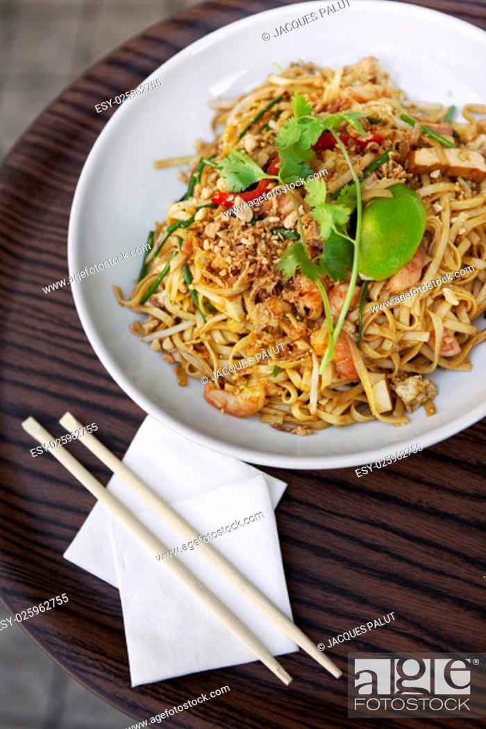Stock Photo: Asian noodles, pork, shrimp and eggplant on a plate.