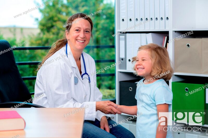 Stock Photo: female pediatrician in white lab coat and the little patient.