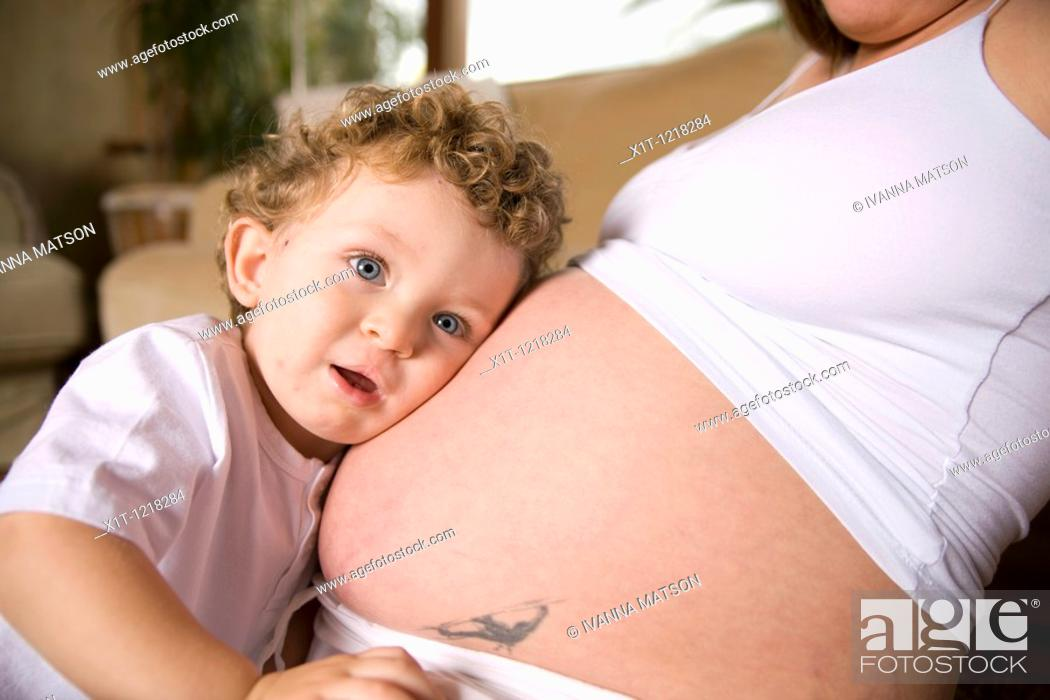 Stock Photo: Pregnant woman and son.