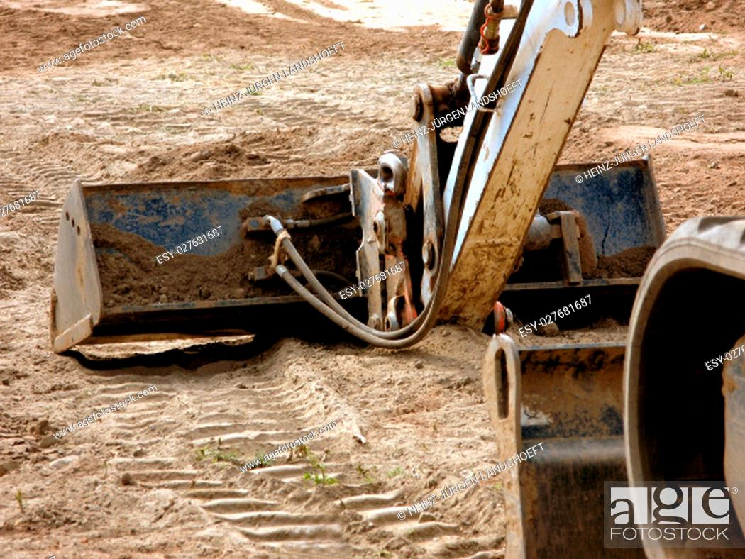 Stock Photo: excavator at construction site.