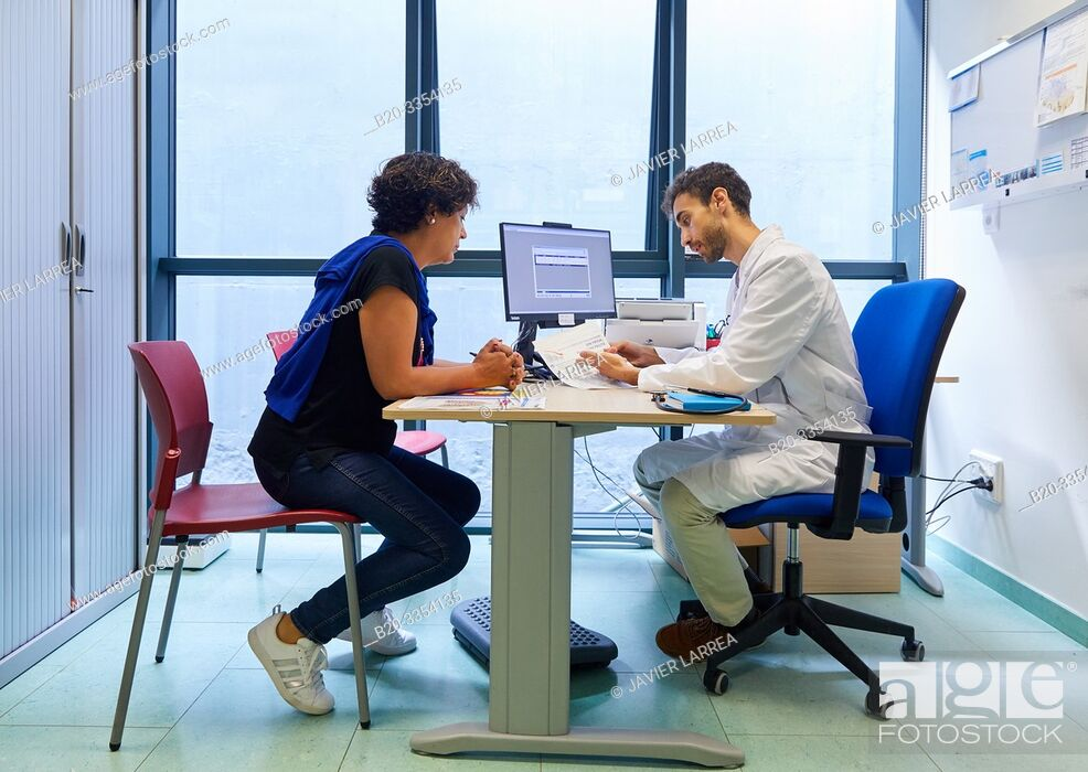 Stock Photo: Doctor, attending to a patient, Medical consultation, Primary care, Egia Health Center, Donostia, San Sebastian, Gipuzkoa, Basque Country, Spain.