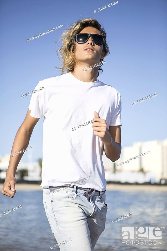 Stock Photo: Confident man near the water.