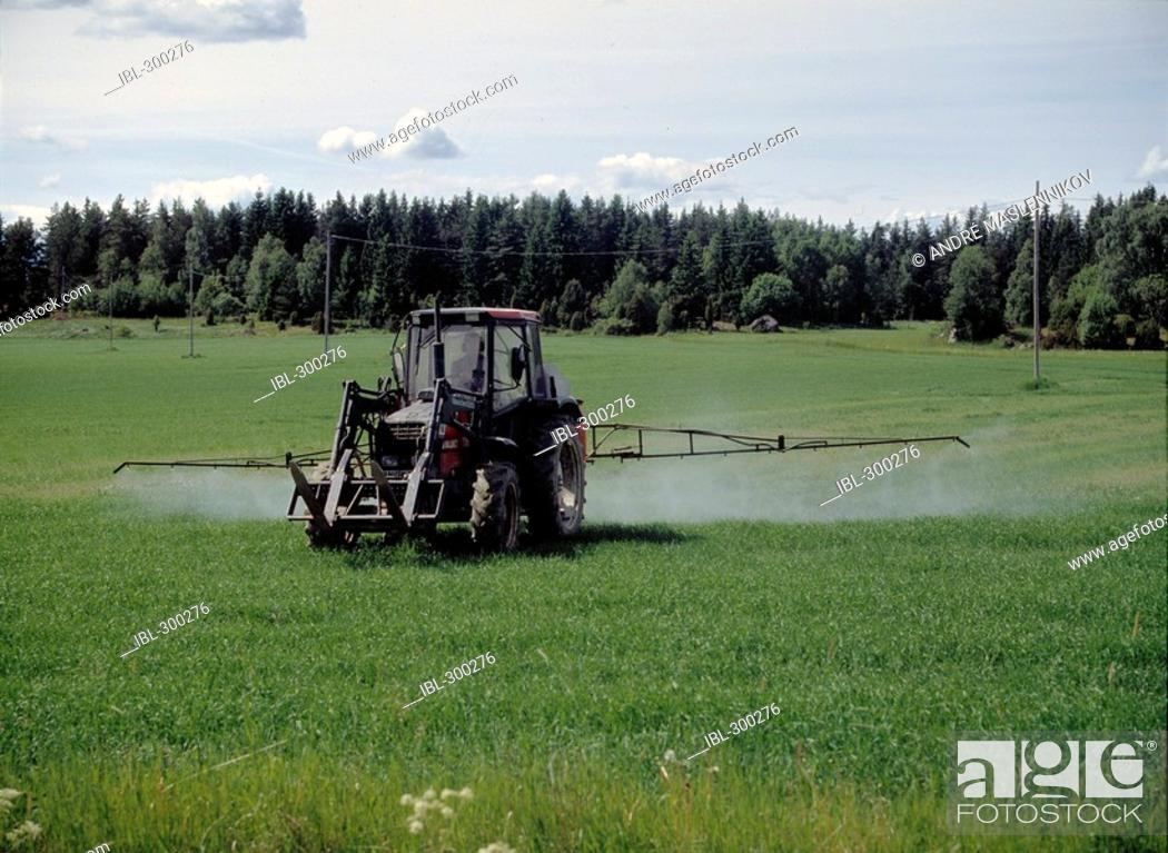 Stock Photo: Spraying of agricultural region.