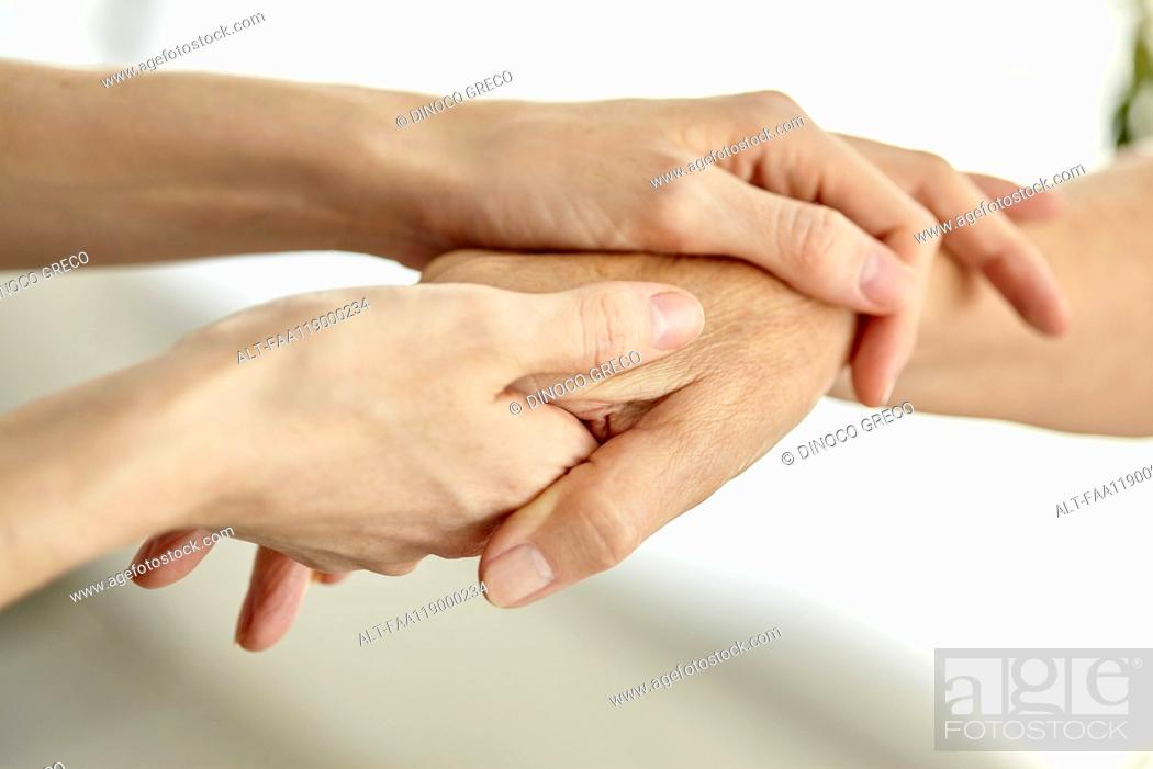 Stock Photo: Nurse holding patient's hand.