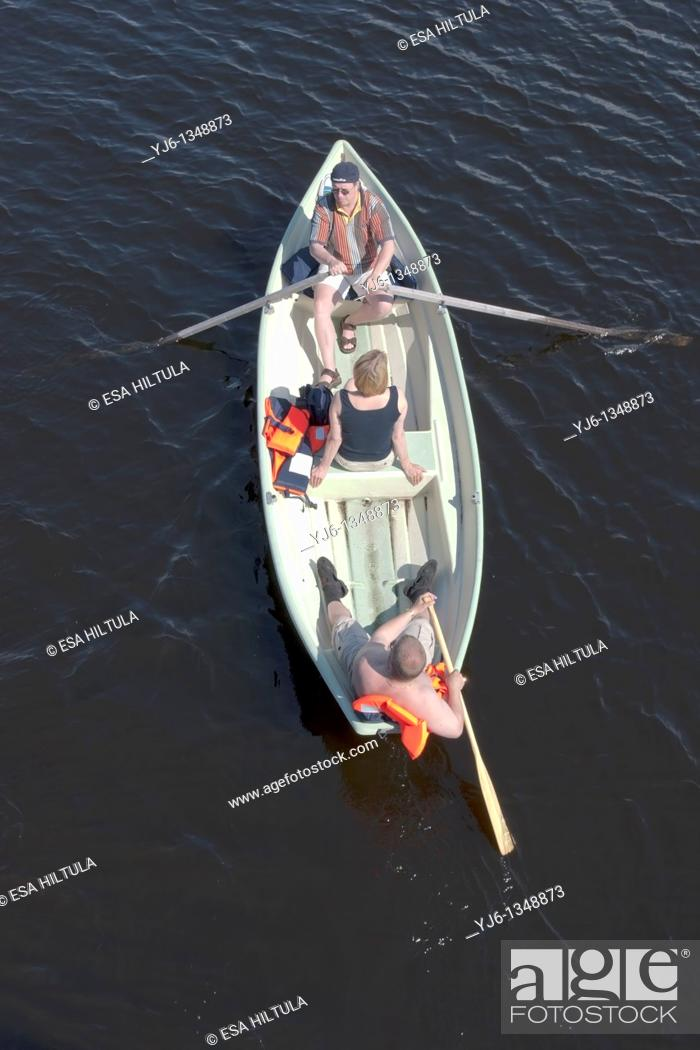 Stock Photo: three people in rowing boat.