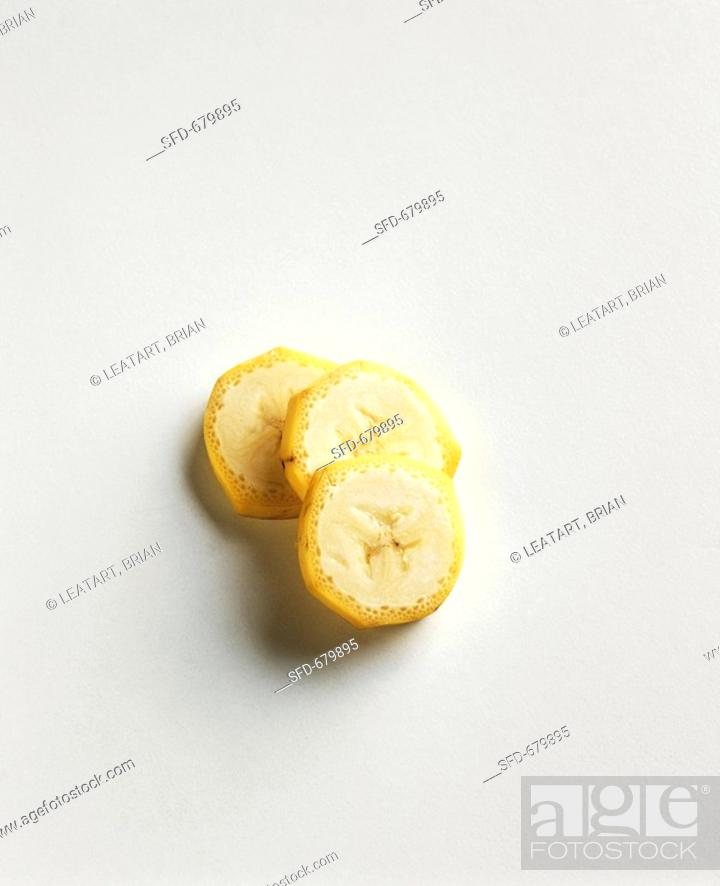 Stock Photo: Three Slices of Yellow Summer Squash on a White Background.
