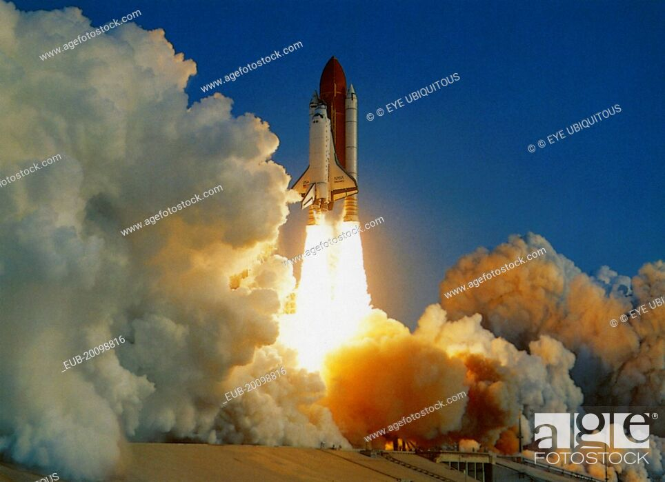 Stock Photo: NASA Space Shuttle lifting off amidst thick white clouds of smoke and flames from rocket boosters.