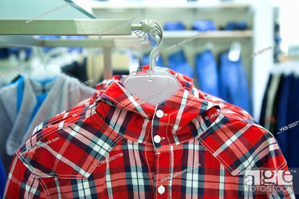 Stock Photo: Close-up of blouse, shirt on hanger. Rack, colorful clothing. Fashion in retail store, shop.