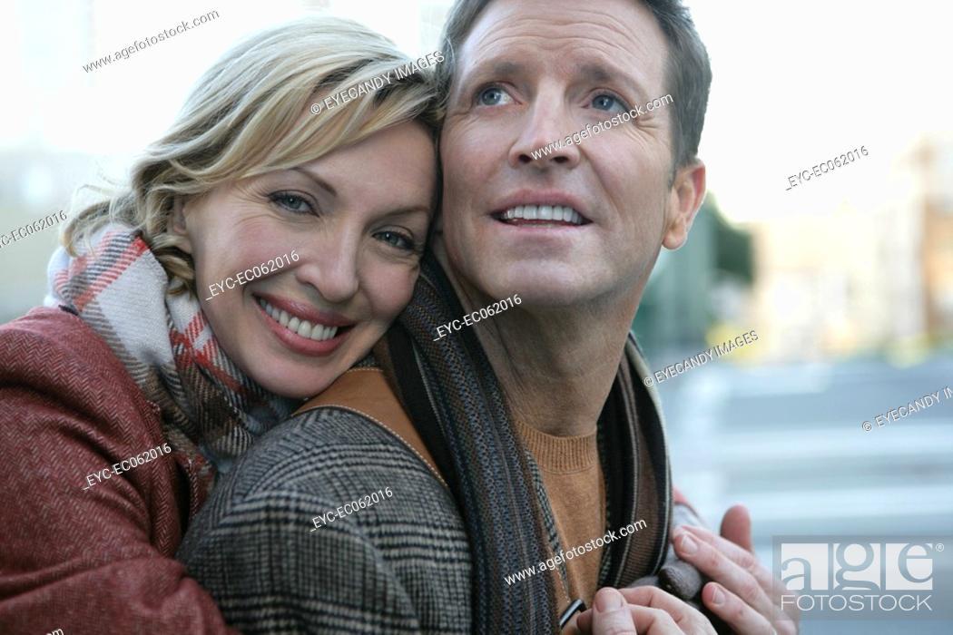 Stock Photo: Mature couple embracing outdoors.