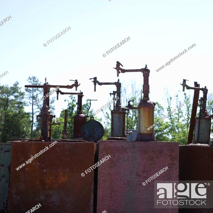 Stock Photo: Old rusted metal machinery silhouetted against sky.