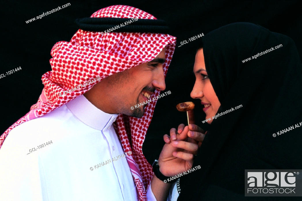 Stock Photo: Man feeding woman with a date.