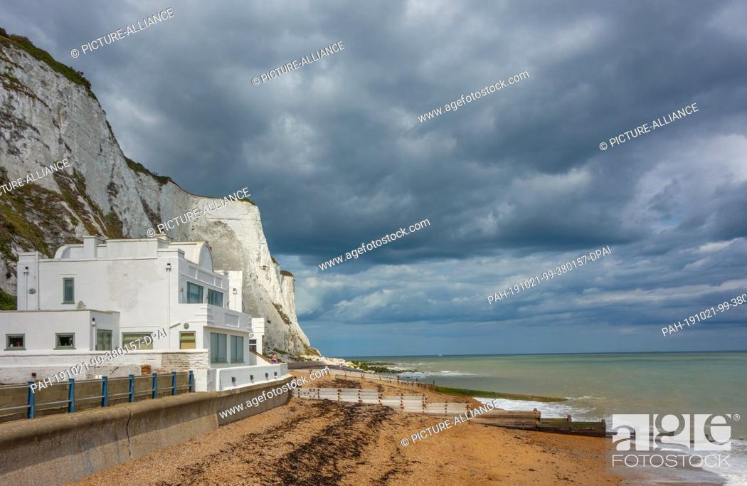 Stock Photo: 15 August 2019, England, Dover: Chalk cliffs, also called white cliffs, near the harbour town. Photo: Patrick Pleul/dpa-Zentralbild/ZB.