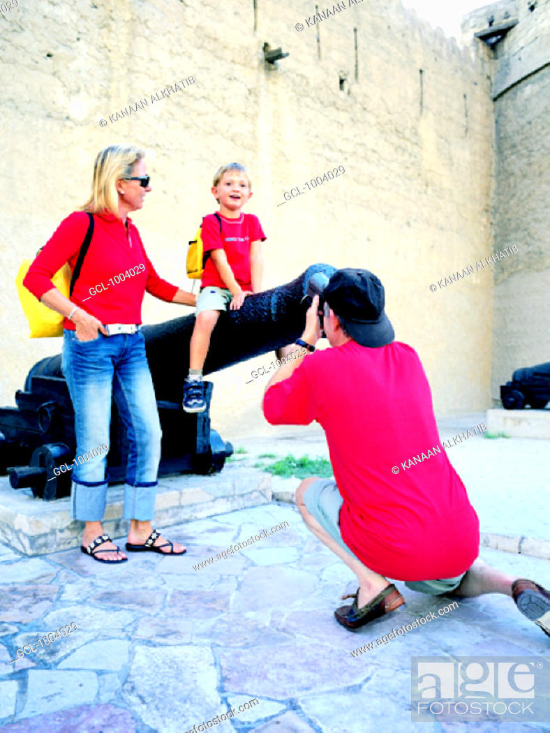 Stock Photo: Western family in front of the Dubai Museum, United Arab Emirates.