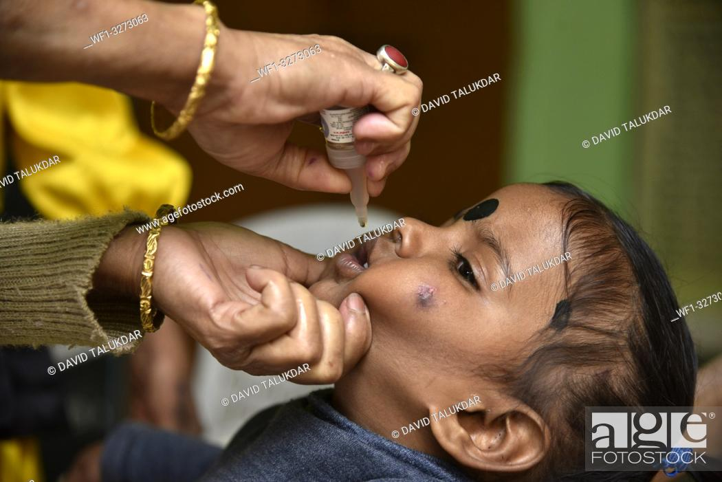 Stock Photo: Guwahati, Assam, India. March 10, 2019. An Indian child receives polio vaccine drops on National Immunisation Day in Guwahati.