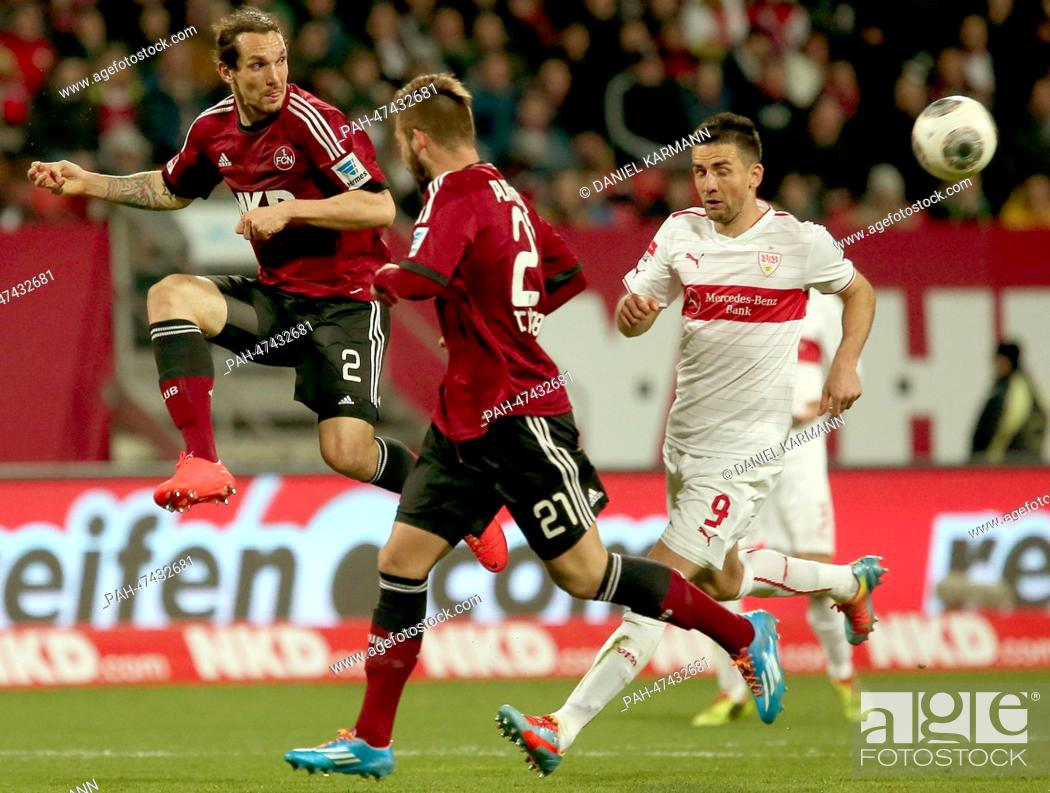 Stock Photo: Nuremberg's Emanuel Pogatetz (L) vies for the ball with Stuttgart's Marvin Plattenhardt (C) during the German Bundesliga match between FC Nuremberg and VfB.