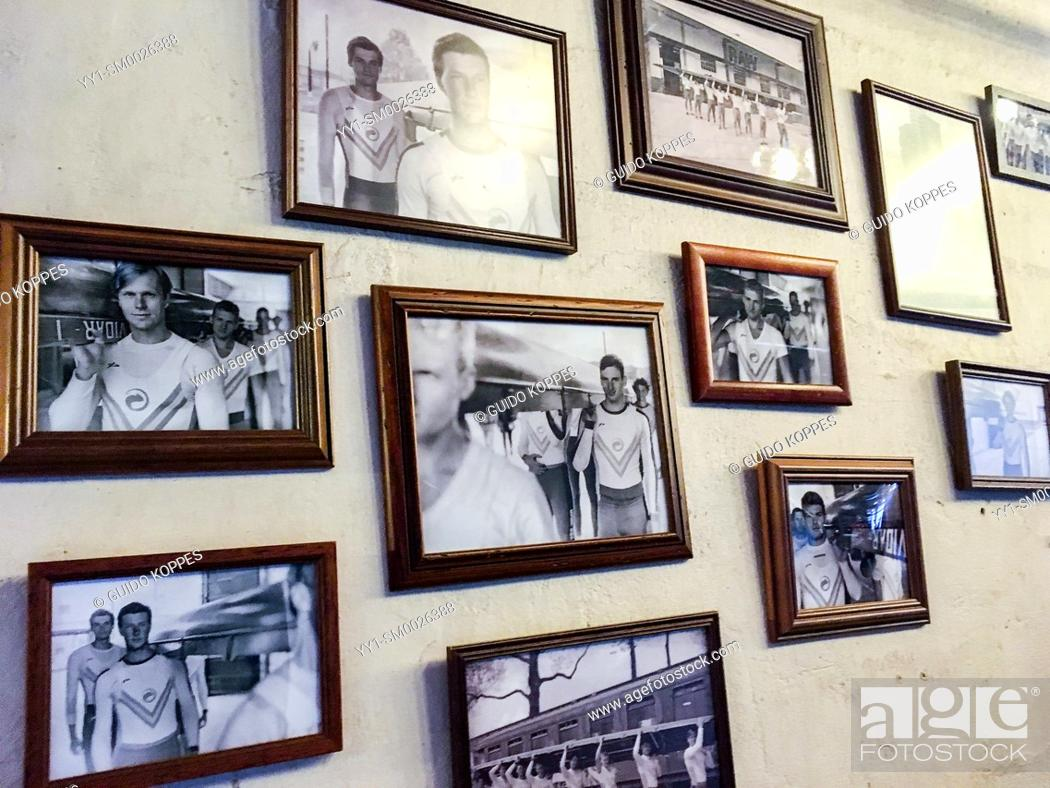 Imagen: Tilburg, Netherlands. Collection of Photographs and Photo Frames showing sports men on an interior cafe wall as interior decoration.