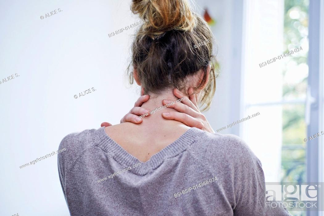 Stock Photo: woman suffering from cervical pain.