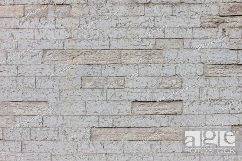 Stock Photo: gray color of design decorative cracked real stone wall surface.