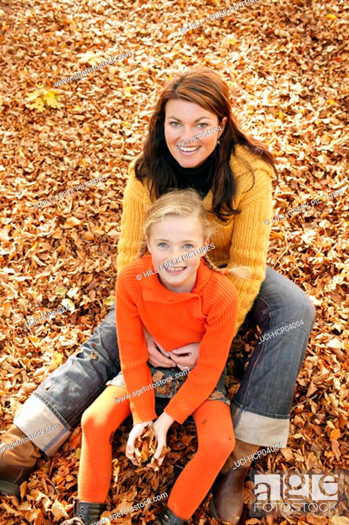 Stock Photo: Mother and daughter sitting together.