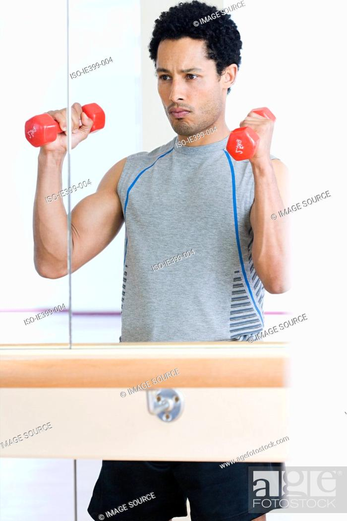 Stock Photo: Man with dumbbells.