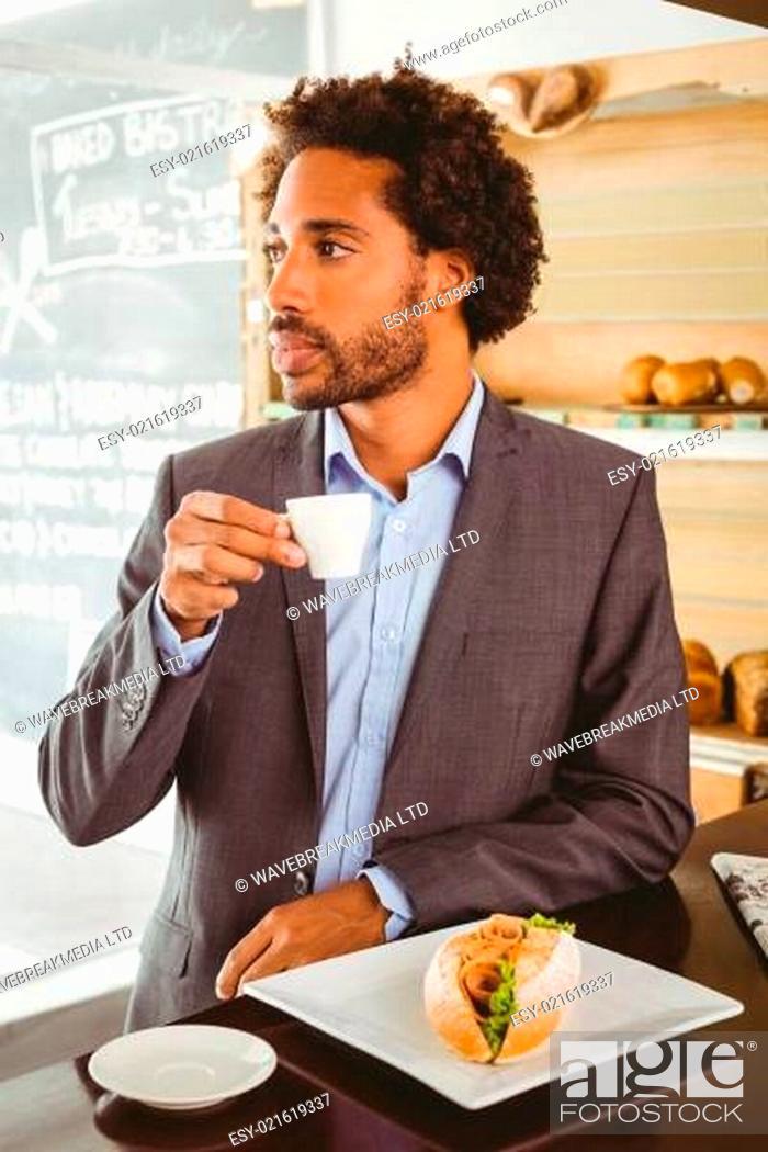 Stock Photo: Businessman enjoying his lunch hour.