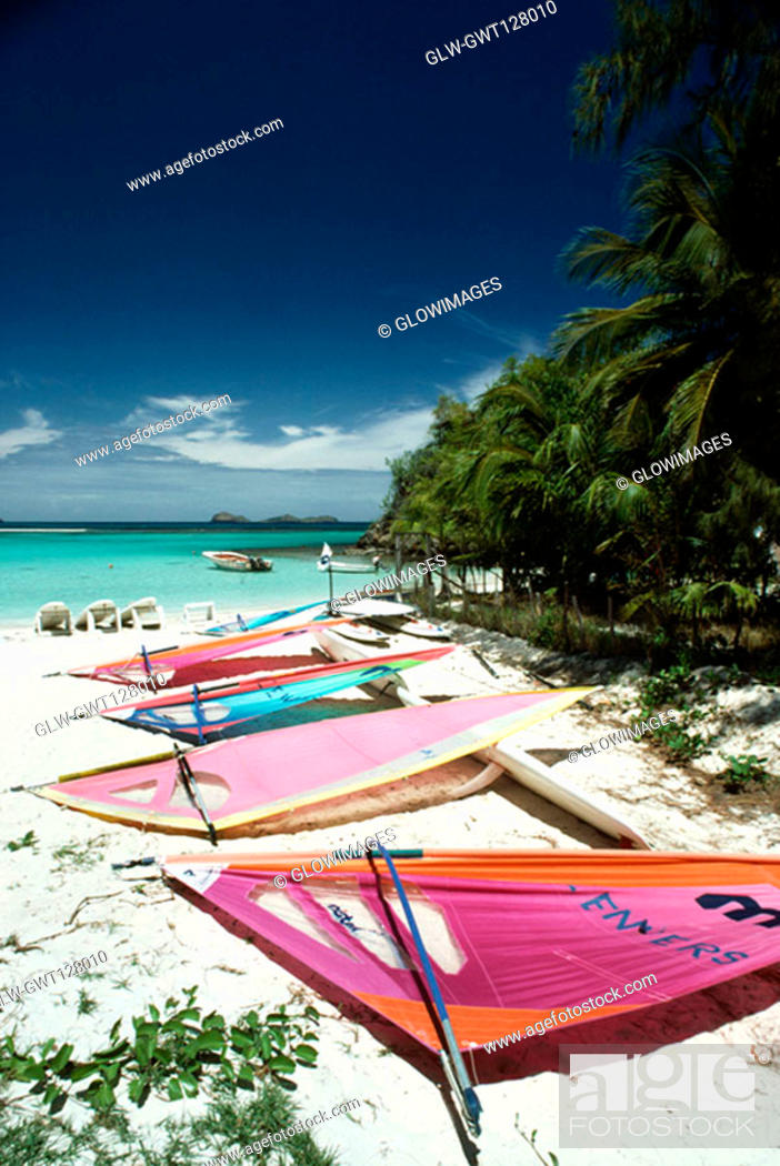 Stock Photo: Colorful sails lying on a serene beach, St. Bant's.