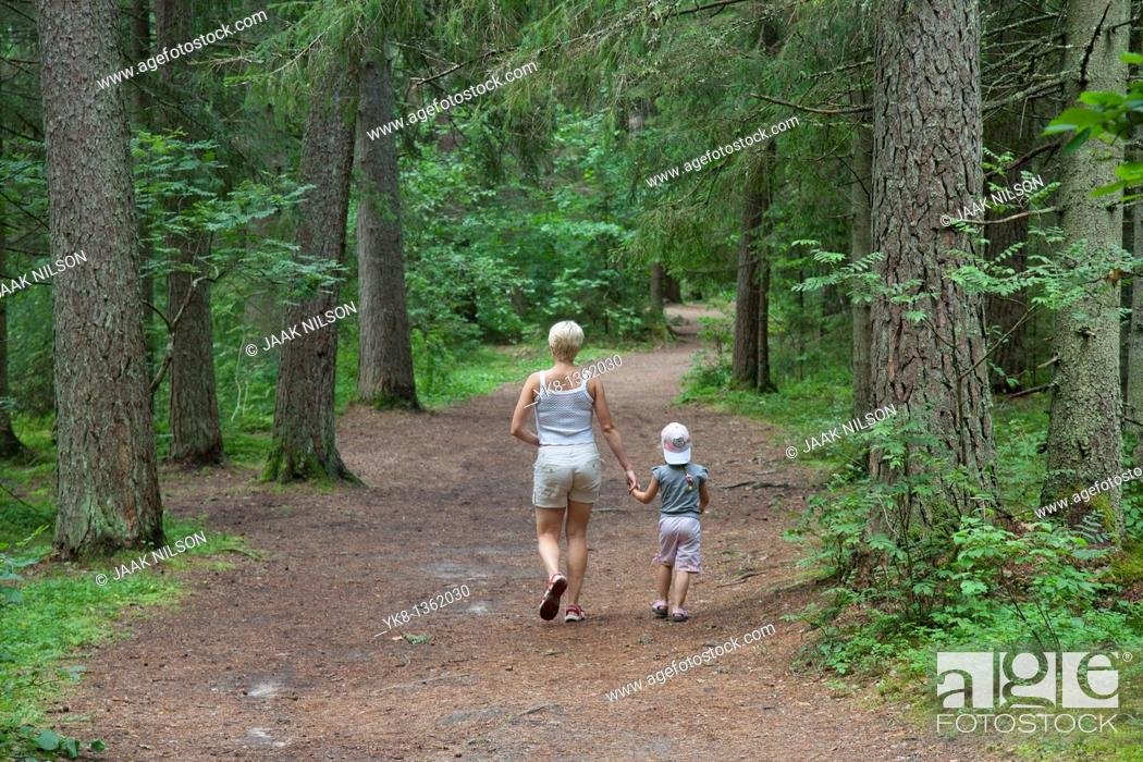 Stock Photo: Mother and Young Girl Walking in Forest Holding Hands, Põlva County, Estonia.