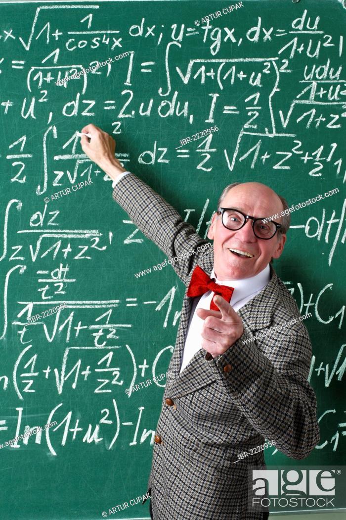 Professor, teacher, blackboard, mathematic formulas, equations ...