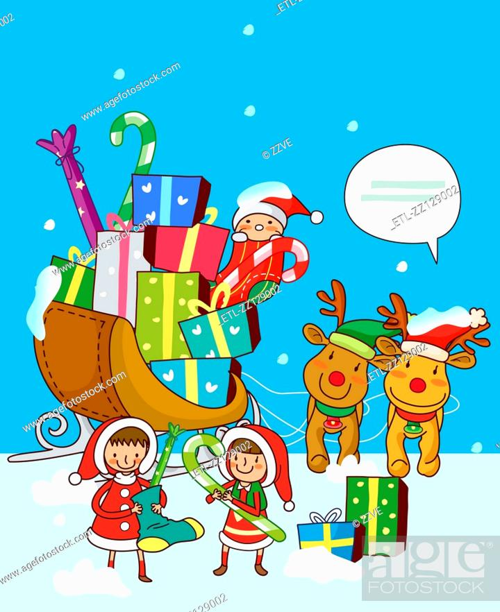 Stock Photo: Girls standing near a sleigh of Christmas presents.