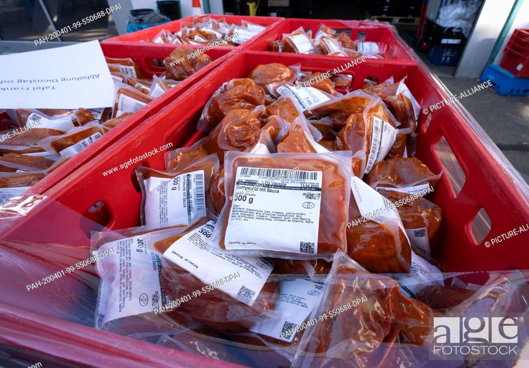Stock Photo: 01 April 2020, Hessen, Frankfurt/Main: Boxes of frozen curry sausage, which were delivered by a refrigerated truck from a Deutsche Bahn warehouse in Leipzig.