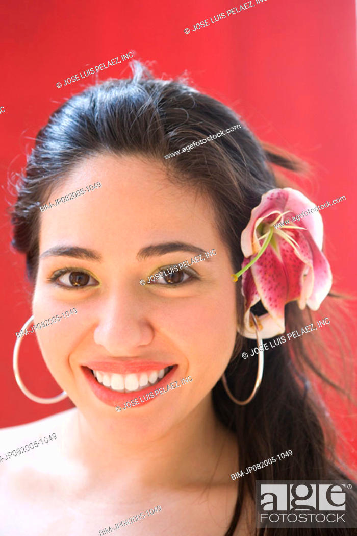 Stock Photo: Portrait of woman with flower in hair.
