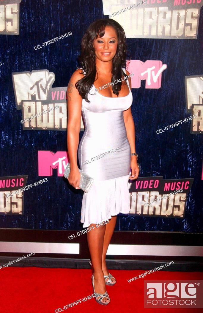 Melanie Brown Wearing A Herve Leger Dress At Arrivals For MTV