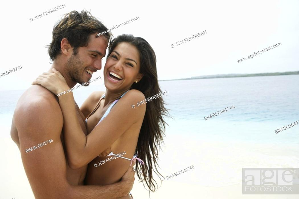 Stock Photo: South American couple hugging.