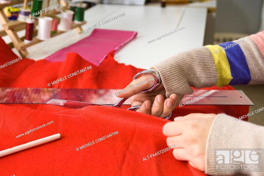 Stock Photo: Cutting fabric.