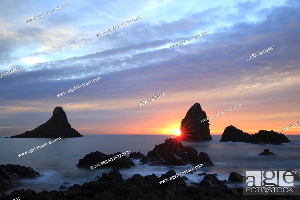 Stock Photo: Cyclops stacks in Aci Trezza at sunrise, Sicily, Italy.