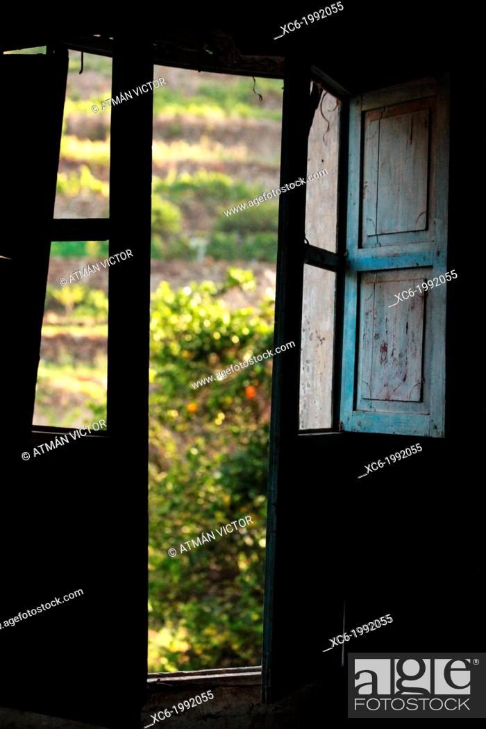 Stock Photo: wide open window of a farm house in tenerife island spain.