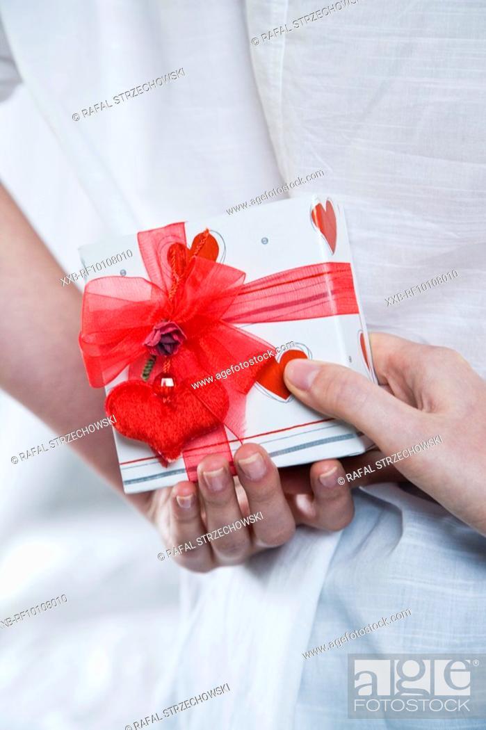 Stock Photo: Woman giving man a present.