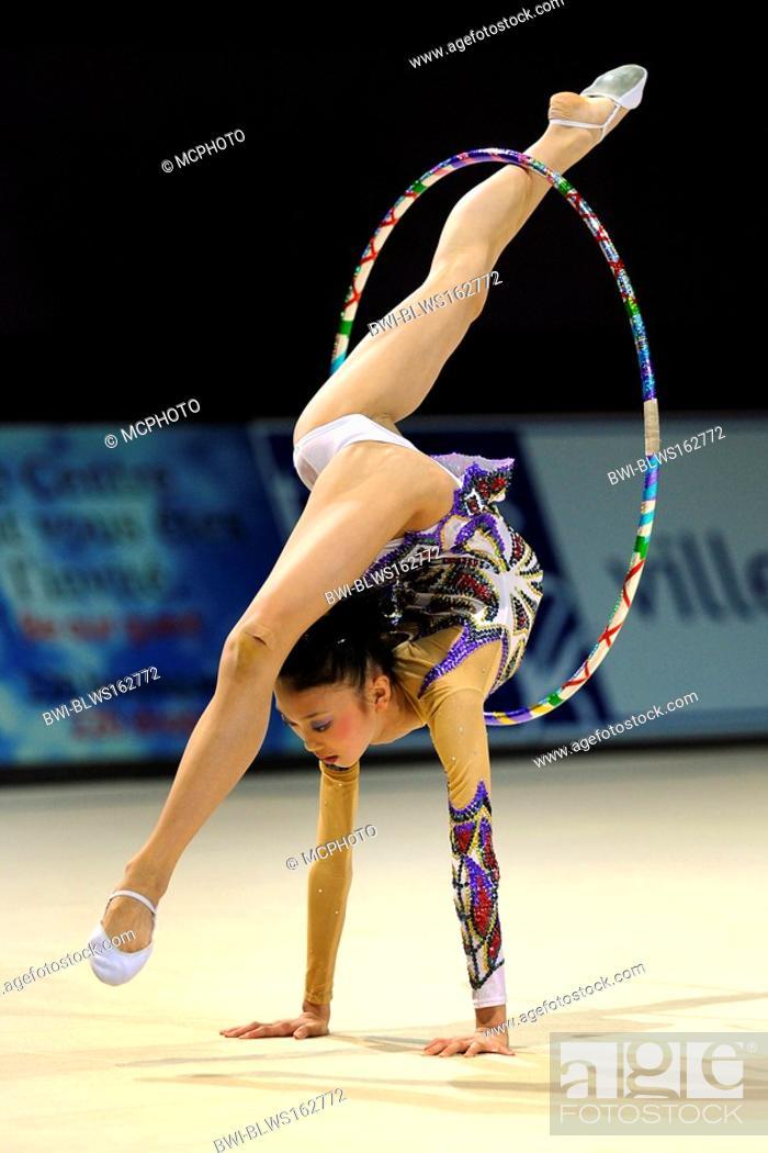Stock Photo: woman doing rhythmic gymnastics with hoop.