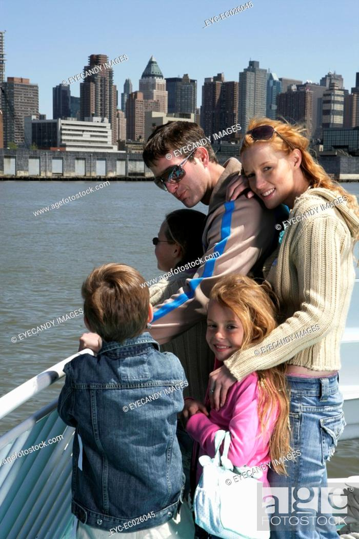 Stock Photo: Family sightseeing on a ferry.