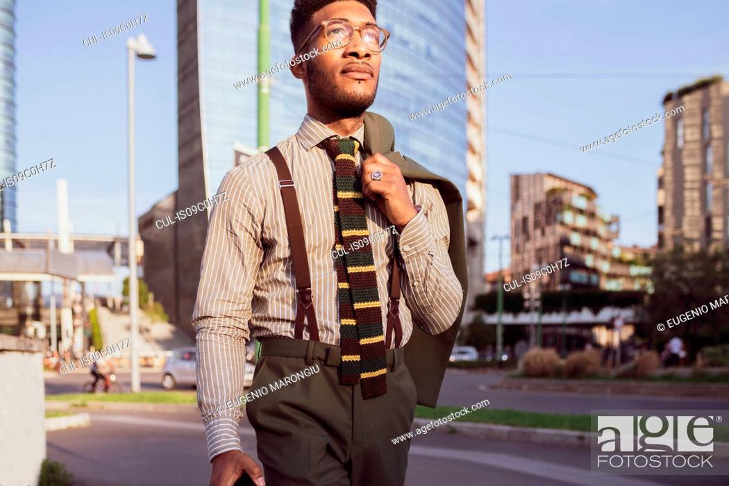 Stock Photo: Businessman walking in city, Milano, Lombardia, Italy.